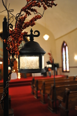 Detail of our Exclusive Pew Lanterns decorated for a Fall Indiana wedding at The historic Olde North Chapel