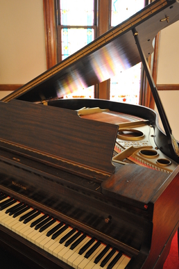 Vintage Baby Grand Piano at the historic Olde North Chapel, Indiana wedding ceremony site.